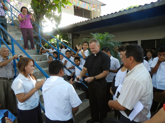 Father Keane officially blesses and dedicates the classrooms at Pablo VI